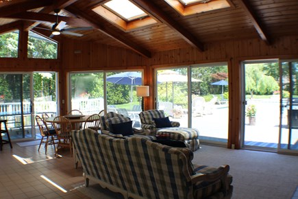 Brewster Cape Cod vacation rental - Enormous sun room walks out to pool and patio
