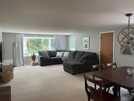 Eastham Cape Cod vacation rental - Living room/dining area (65' smart TV and super comfy couch!)