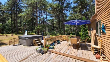 Wellfleet Cape Cod vacation rental - Large deck with hot tub, dining area and gas grill