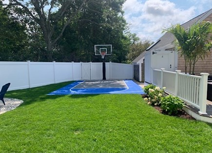 Centerville Cape Cod vacation rental - Sport court with fire pit off to the left with 6 chairs