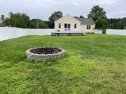Hyannis, Barnstable Cape Cod vacation rental - Back yard with fire pit and patio