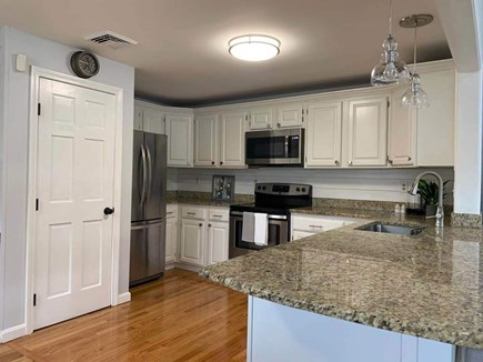 Hyannis, Barnstable Cape Cod vacation rental - Open Kitchen with a neutral granite countertop.