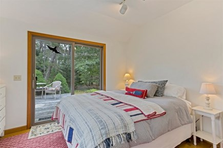 Wellfleet Cape Cod vacation rental - Primary Bedroom with Queen Bed and Access to Deck
