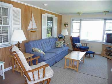 West Dennis Cape Cod vacation rental - Family room with view of Uncle Steven's Pond