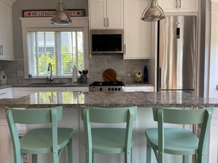 Provincetown Cape Cod vacation rental - Kitchen with island and stainless steel applicances.