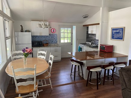 Falmouth Cape Cod vacation rental - A full kitchen with a large table that has room for six.