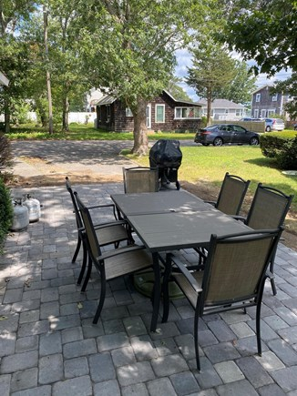 Falmouth Cape Cod vacation rental - Outdoor seating area with a grill.