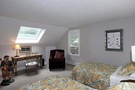 Bourne, Monument Beach Cape Cod vacation rental - 2nd floor bedroom.  AC, 2 single beds, sitting area and desk.