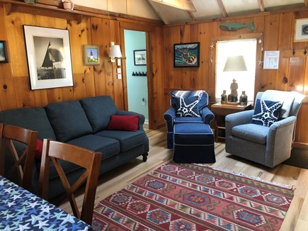 Eastham Cape Cod vacation rental - Cozy knotty pine living area with seating and pub height table