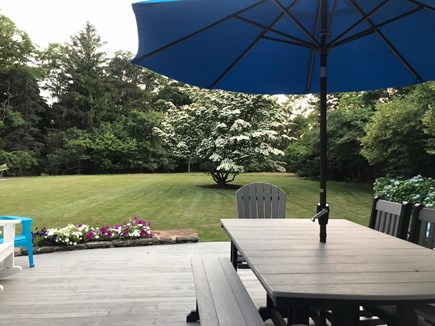 Eastham Cape Cod vacation rental - Back deck with 2 tables with umbrellas and gas grill