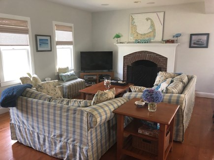Eastham Cape Cod vacation rental - Family room with comfy couches, fireplace and TV