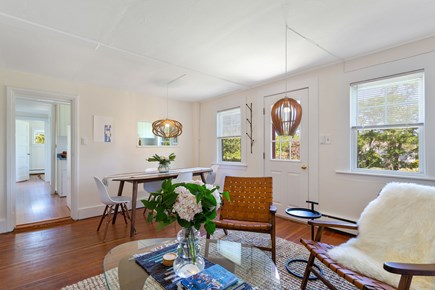 Truro Cape Cod vacation rental - Mid-century themed living and dining area. Large Smart TV