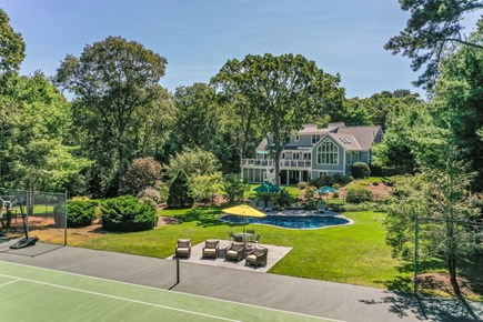 Orleans Cape Cod vacation rental - View from Tennis Court to Pool and House