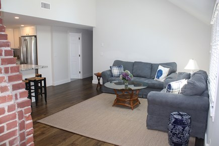 West Hyannisport Cape Cod vacation rental - Living room, hallway leads to the 3 bedrooms