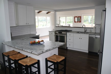 West Hyannisport Cape Cod vacation rental - Kitchen with 4 bar stools, views out to deck and creek.