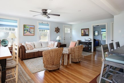 Sandwich Cape Cod vacation rental - Cozy seating, ceiling fan, and plenty of dining space