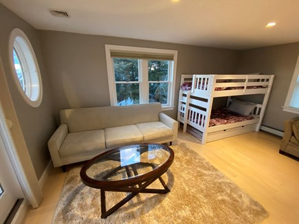 Bourne Cape Cod vacation rental - Open sleep area with bunk beds (3 twins) and queen sleeper sofa