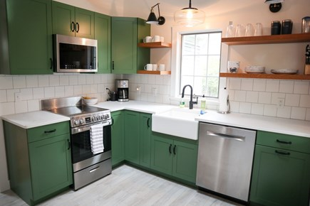 Brewster Cape Cod vacation rental - Renovated kitchen with basil green cabinets -- striking!