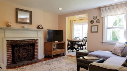 Dennis Port Cape Cod vacation rental - Living room and dining room with working fireplace.