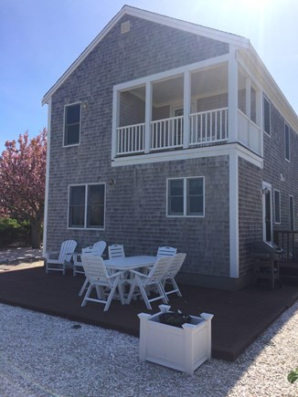 Dennis Cape Cod vacation rental - 2nd Floor Deck and ground level dining furniture