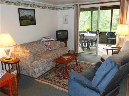 West Barnstable Cape Cod vacation rental - Living room with plenty of seating, games for kids