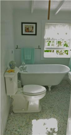 North Eastham Cape Cod vacation rental - Cool stone floor, reconditioned antique tub- Outdoor shower too.