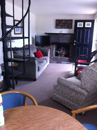 East Sandwich Cape Cod vacation rental - Cozy living area with spiral staircase to second floor.