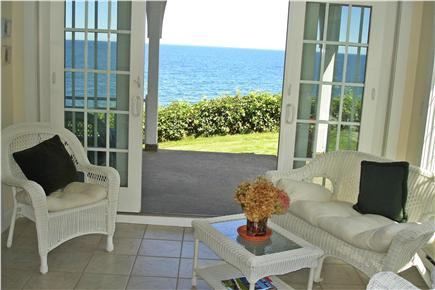 Sagamore Beach, Bourne Sagamore Beach vacation rental - Step out onto the ocean porch from the cozy sunroom.