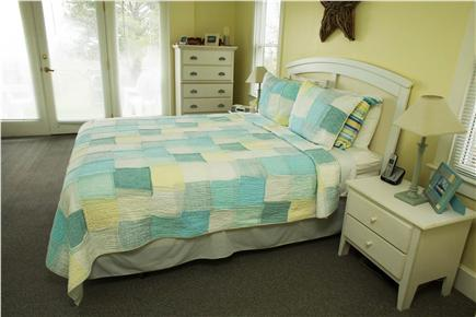 Barnstable Cape Cod vacation rental - Master bedroom with queen bed, master bath, sitting area & view.