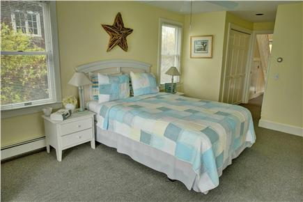 Barnstable Cape Cod vacation rental - Master bedroom with queen bed, master bath, sitting area, & view