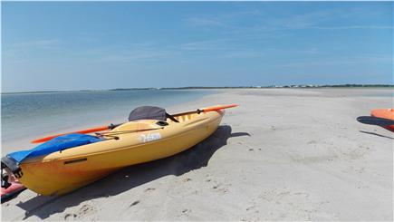 Barnstable Cape Cod vacation rental - Kayaks at sandbar at low tide in front of house.