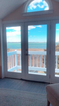 Barnstable Cape Cod vacation rental - View from inside looking out at the ocean (during fall season).