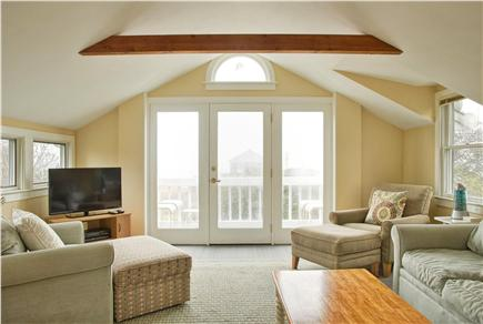 Barnstable Cape Cod vacation rental - Living room looking out to deck.