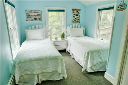Barnstable Cape Cod vacation rental - Sun drenched front bedroom with 2 twin beds and full closet.