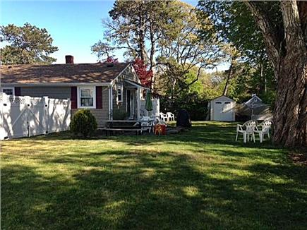 Dennis Cape Cod vacation rental - Backyard shows deck with grill & outdoor shower