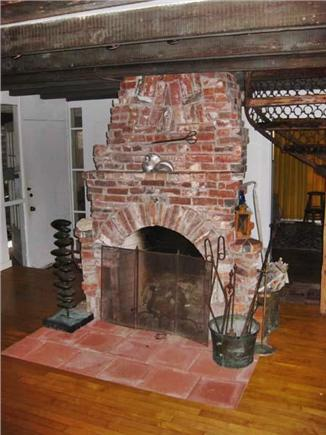 Provincetown Cape Cod vacation rental - Fireplace by Conrad Malicoat (replacing old one above)