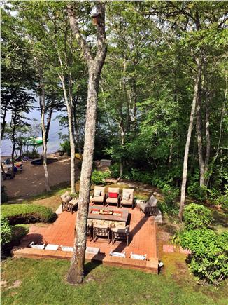 Brewster Cape Cod vacation rental - Fire pit patio, with boats and float raft on the beach