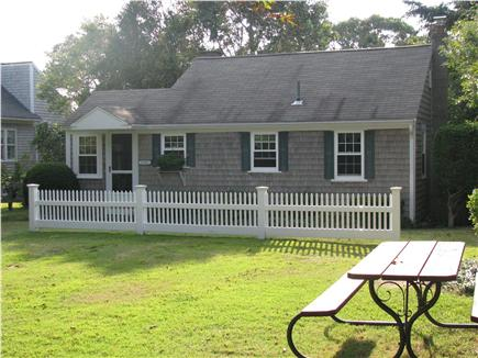 West Dennis Cape Cod vacation rental - Approach to cottage with parking area/picnic table