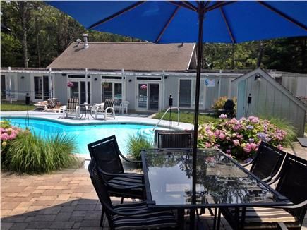 New Seabury Cape Cod vacation rental - Outdoor dining by the pool under the shade of an umbrella
