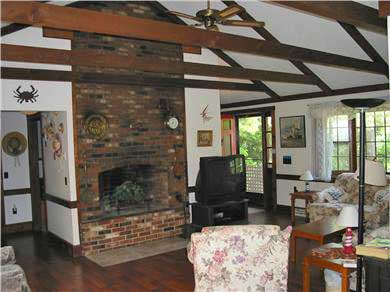 South Chatham Cape Cod vacation rental - Spacious living area with beamed ceilings & fireplace