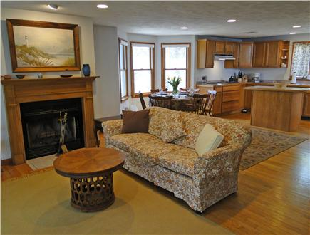 Falmouth Cape Cod vacation rental - Living area with fireplace, hardwood floors, and slider to porch