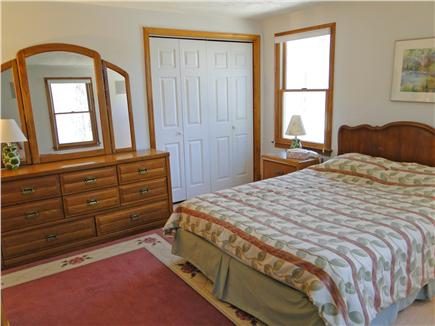 Falmouth Cape Cod vacation rental - Main floor master bedroom w/ queen bed, TV and private bathroom