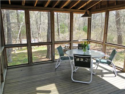 Falmouth Cape Cod vacation rental - Porch with seating, ceiling fan, and skylights