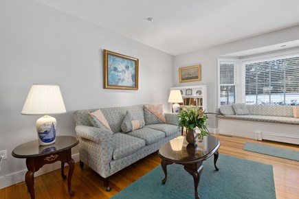 Chatham, downtown Cape Cod vacation rental - Living Room with bay window seat overlooking spacious back yard