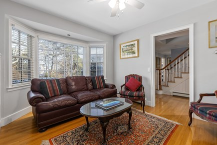 Chatham, downtown Cape Cod vacation rental - Cozy den with TV, queen sleep sofa, pocket doors for privacy.