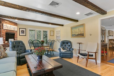 Chatham Cape Cod vacation rental - Family room with game table and passage from the kitchen