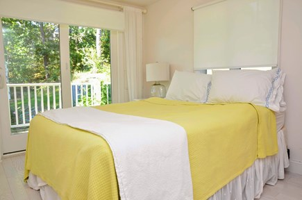 Chatham Cape Cod vacation rental - Master bedroom with queen bed and sliding glass doors to the deck