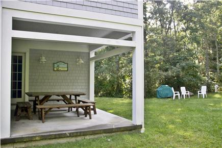 Falmouth, Sippewissett Cape Cod vacation rental - Covered porch with picnic table; perfect for rainy days!