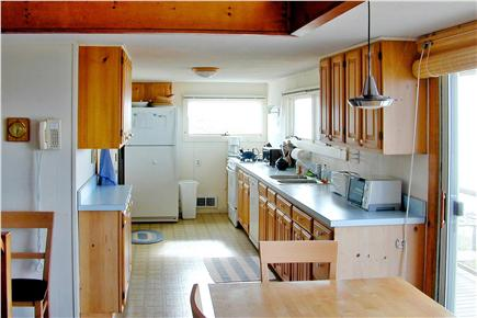 North Eastham Cape Cod vacation rental - Kitchen and dining area with waterfront views