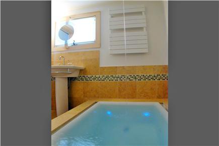 North Eastham Cape Cod vacation rental - Soaking tub, limestone tiled bath